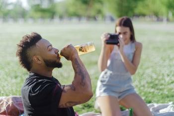 Drinking Jarritos soda in the park