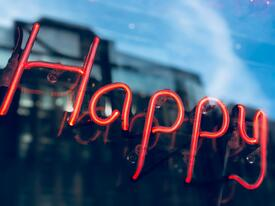 Neon sign with the word Happy | NOW Marketing Group: How to Create a Culture of Happiness