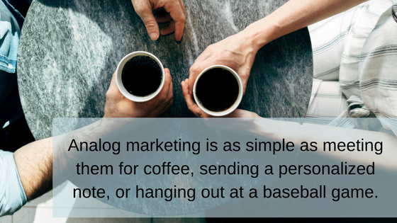 """Overhead view of a coffee date with overlaid words, """" Analog marketing is as simple as meeting them for coffee, sending a personalized message, or hanging out at a baseball game."""""""