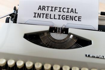 Keyboard with paper that says artificial intelligence