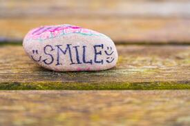 Smile | Image in blog: How to Create a Culture Based on Happiness