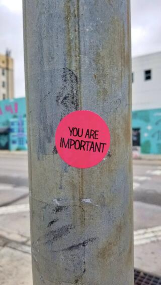 Sticker on a pole that says you are important-1