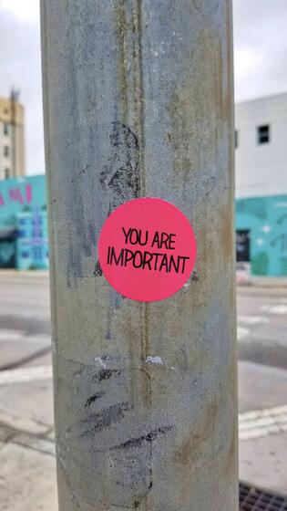 Sticker on a pole that says you are important