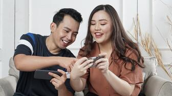 Two people looking at content on their phone-1