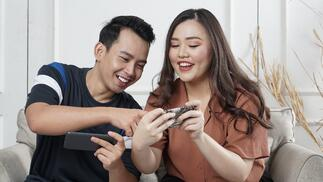 Two people looking at content on their phone-3