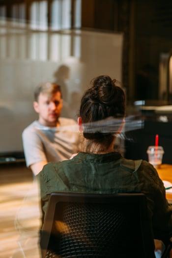 Two people talking in coffee shop