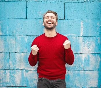 Man happy with hands in celebration