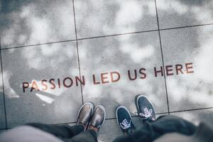 Writing on ground that says passion led us here