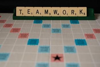 teamwork spelt on scrabble tiles