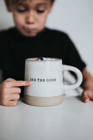 see the good written on coffee cup