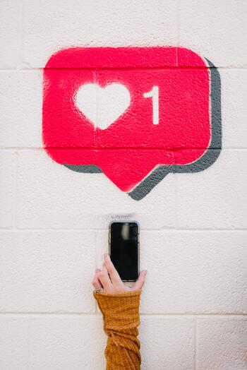 someone with phone and heart