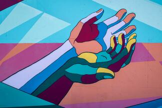 hands outstretched to create connection