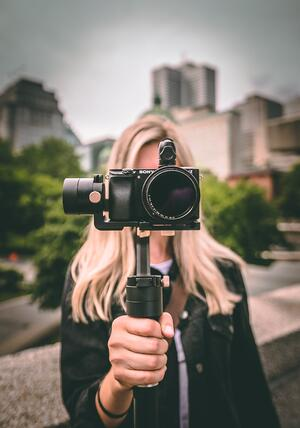 Woman with camera in hand to record video